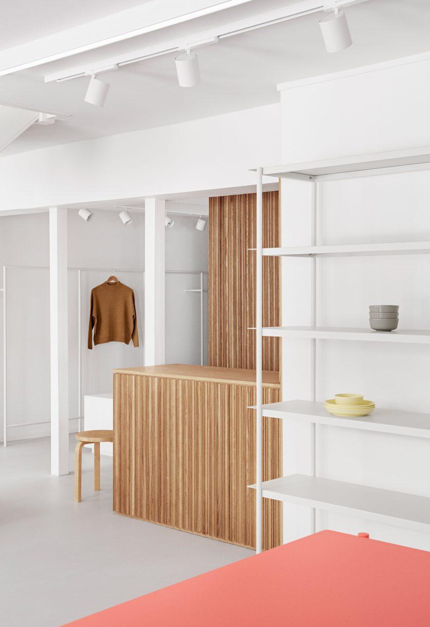 Wooden counter and in the minimalist OCE Copenhagen store interior