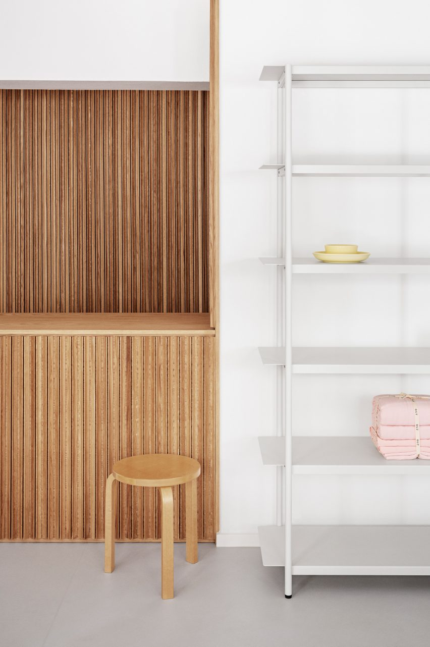 Wooden counter and white shelving in the OCE Copenhagen store interior by Aspekt Office