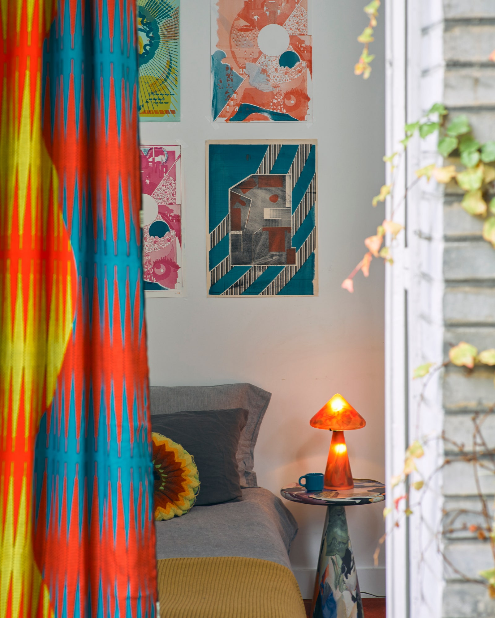pThe bedroom faces a garden. On the walls are prints by Uchronia a Jean Royre chair an orange lamp in Murano glass and a...