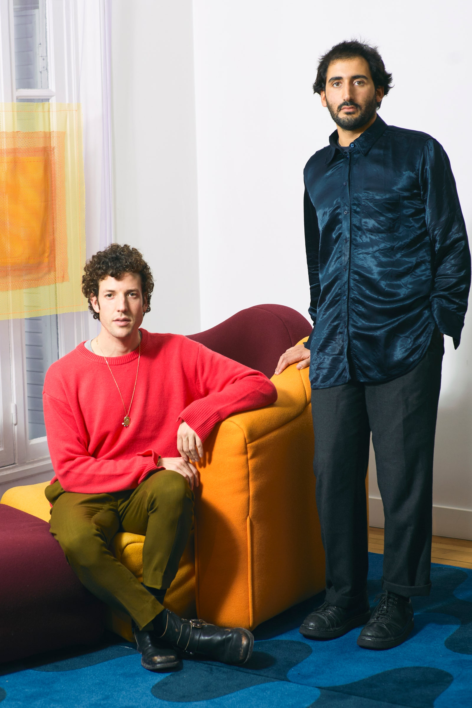 pPortrait of Jonathan Wray seated on a Gaetano Pesce sofa circa 1990 and Julien Sebban. The curtains and carpet are by...