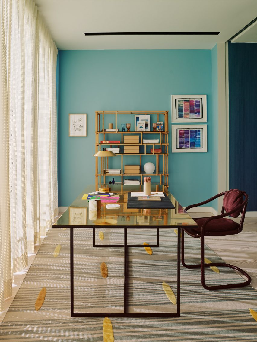 Gold desk in turquoise room
