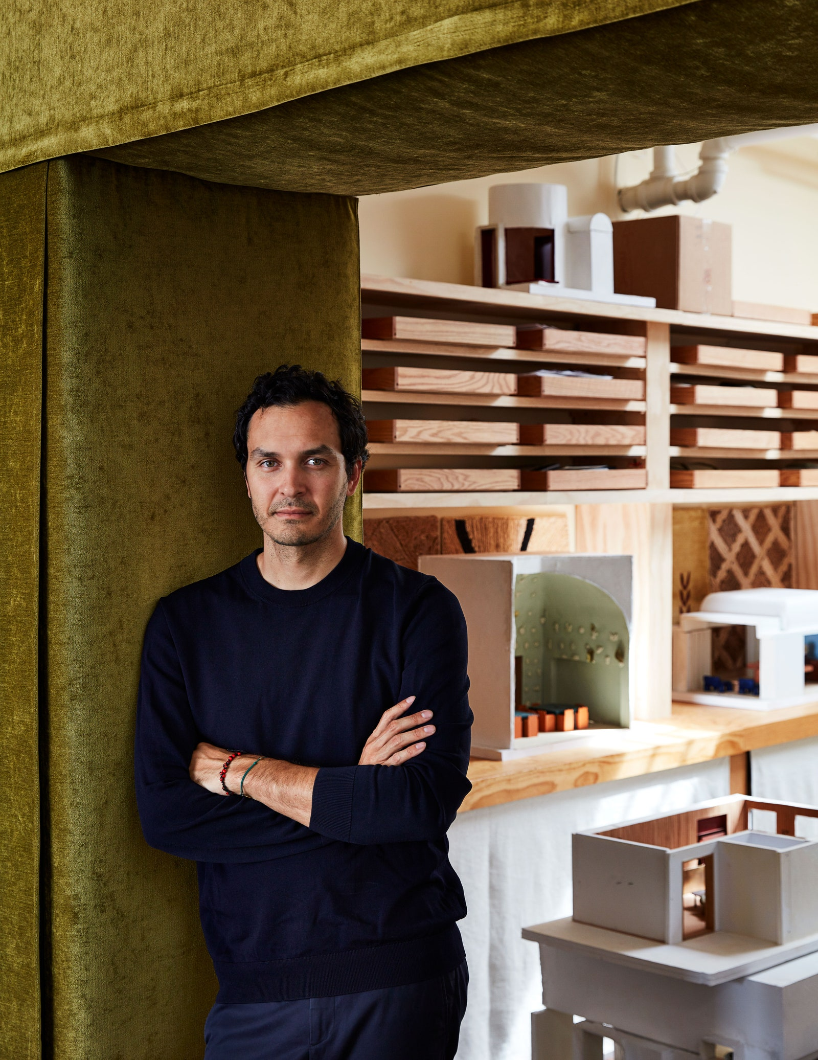 Image may contain Human Person Aden Young Wood Plywood and Shelf