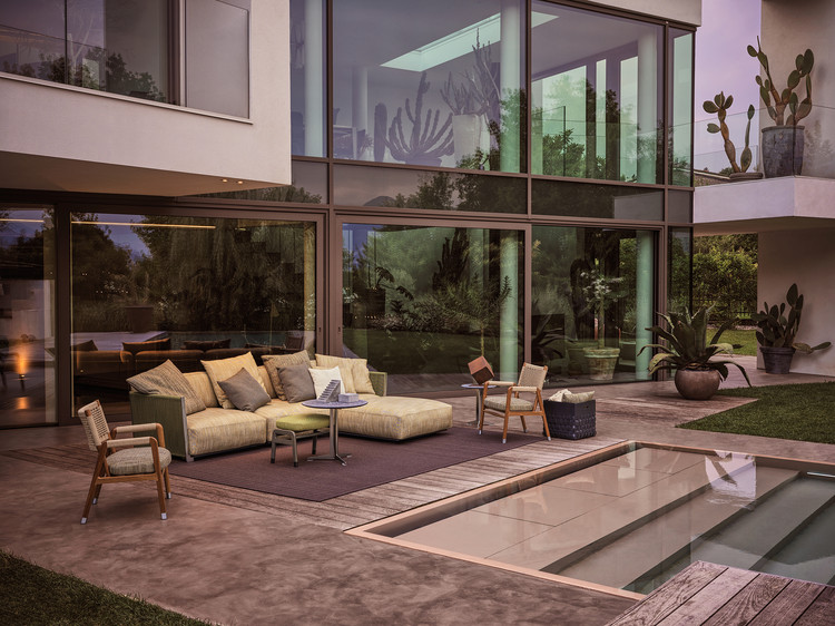 Here the Vulcano sofa is paired with Ortigia Outdoor armchairs and the Fly Outdoor coffee table. Image Courtesy of Flexform