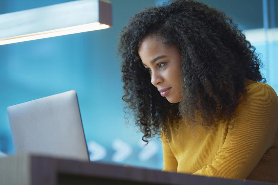 young woman on laptop in office