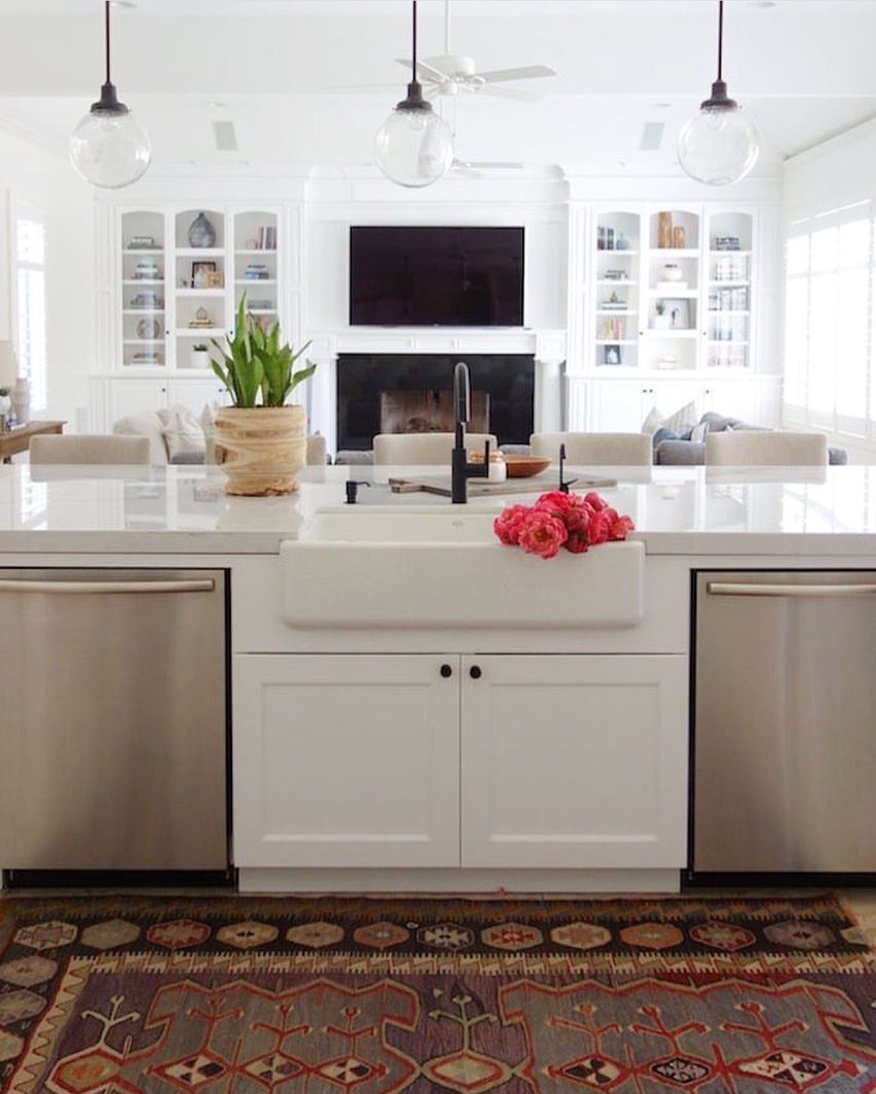 Image may contain Room Indoors Interior Design Kitchen Living Room Kitchen Island Rug Electronics and Monitor