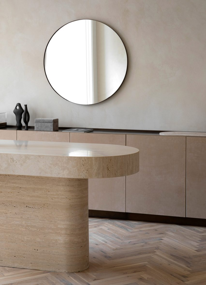 Travertine counter in retail interior by Norm Architects