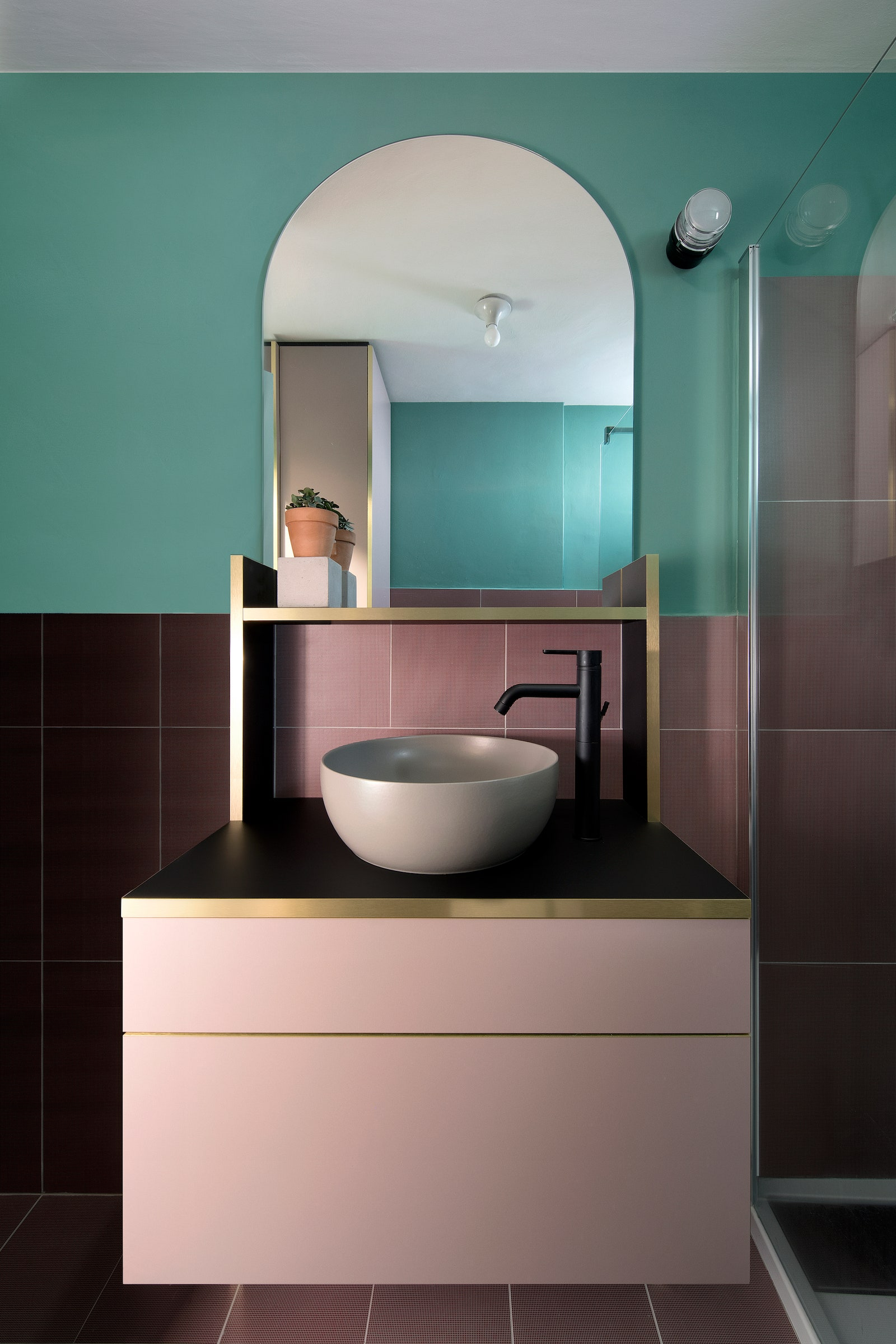 In the bathroom the Graph tiles are by Ceramica Vogue and the Fresnel wall light is by Joe Colombo for Oluce.