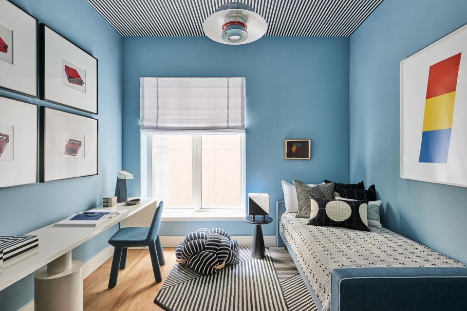 A blue-hued room designed for a child.