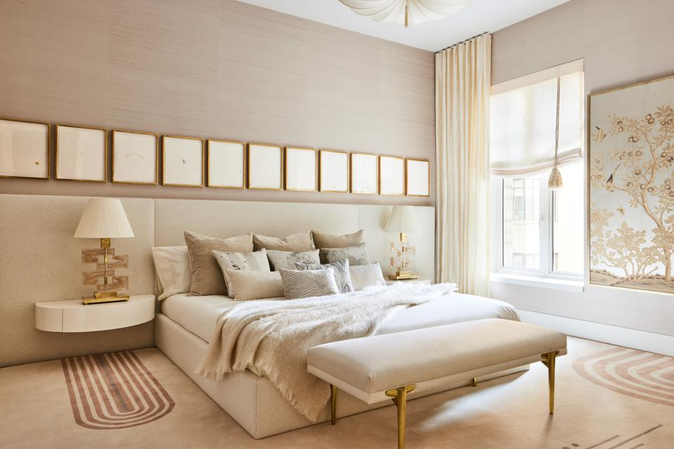 The bedroom in the Living Gallery, which is monochrome in a beige hue.