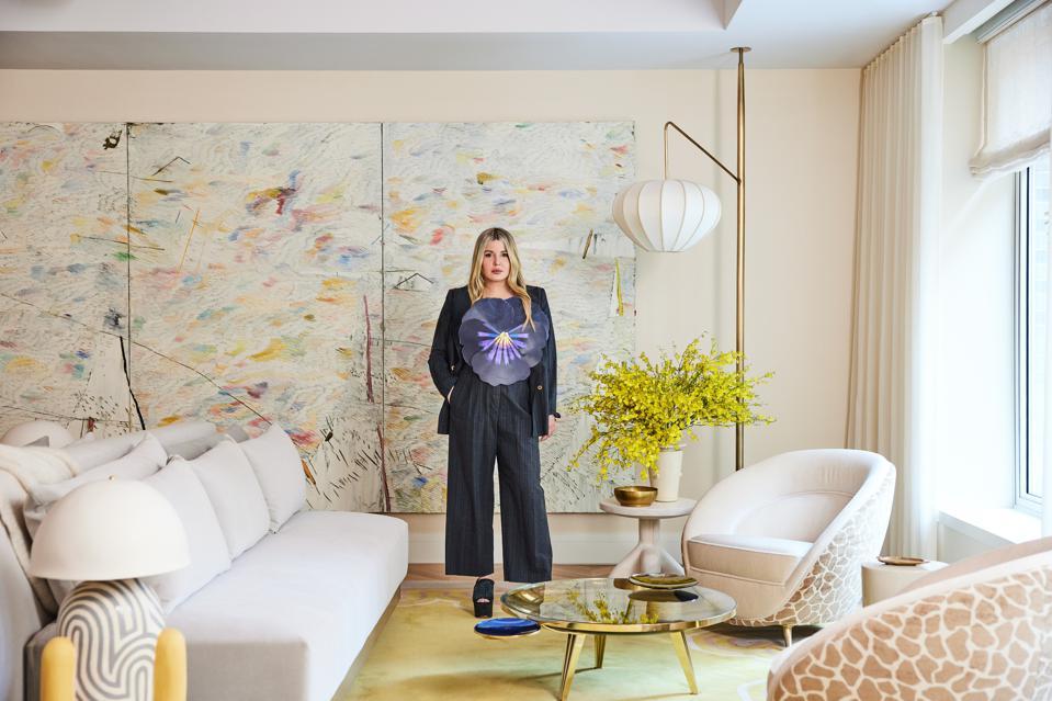 Interior designer Kelly Behun in her pastel-hued, bright, airy space.