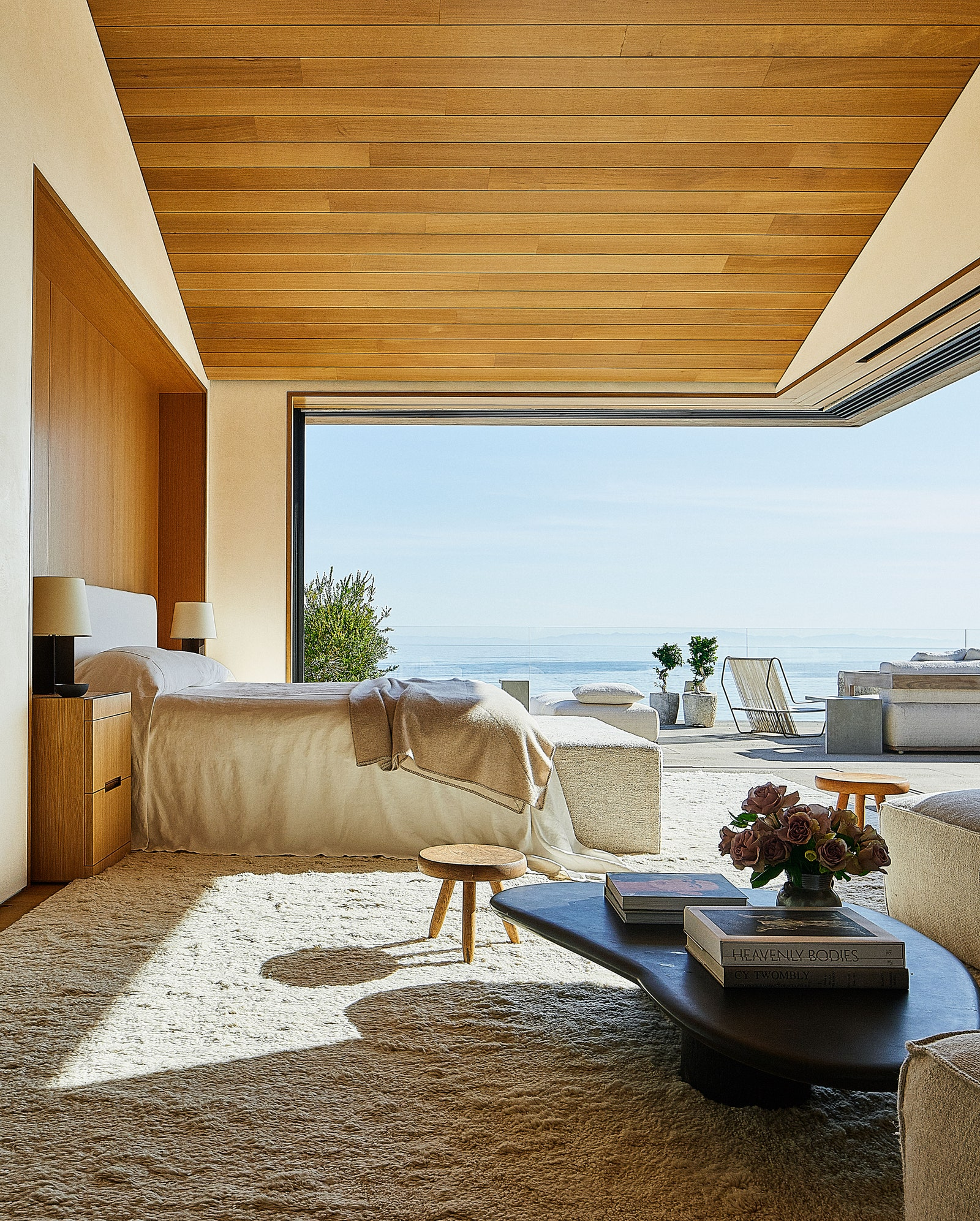 A bedroom that looks out at the ocean