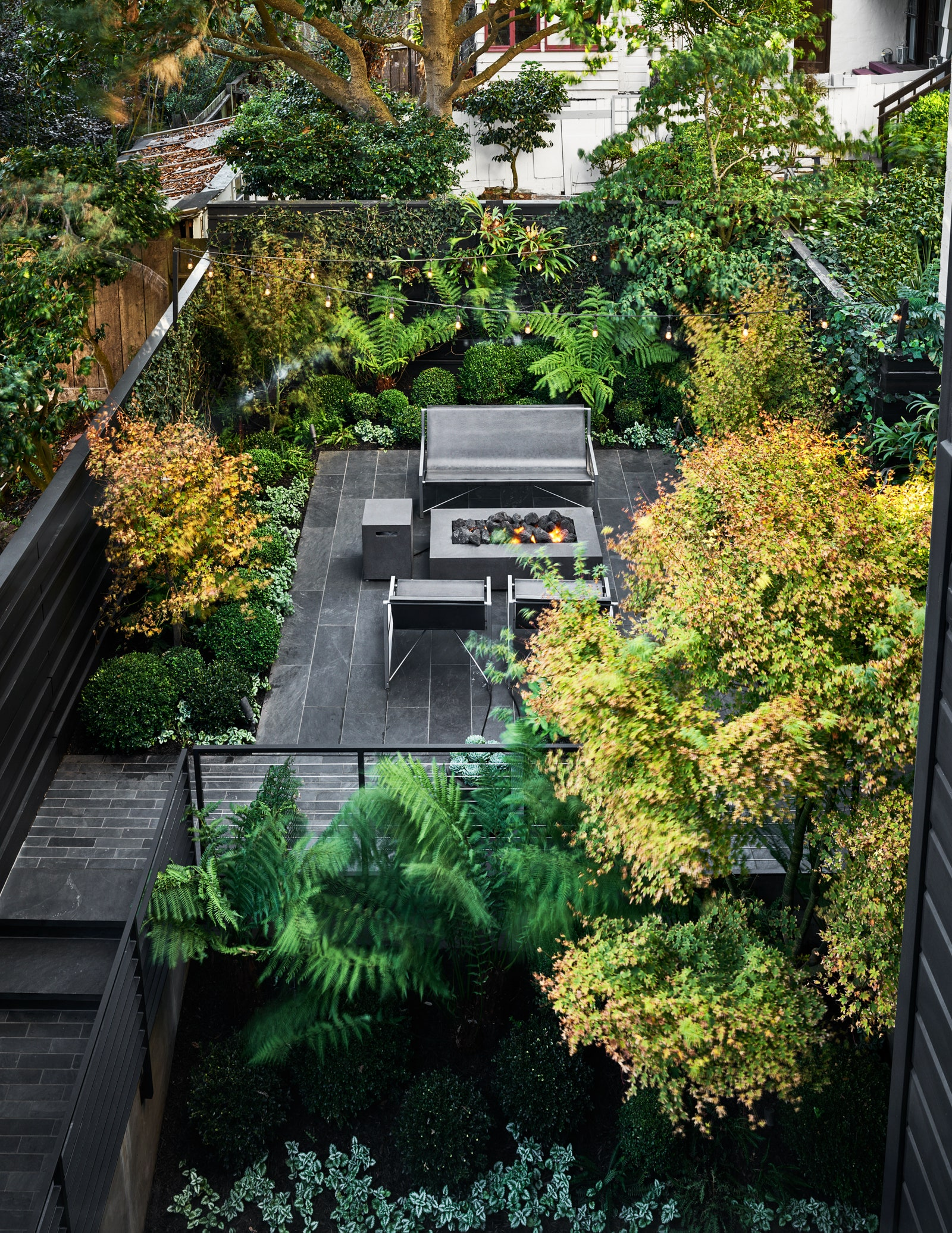 Image may contain Outdoors Garden Arbour Patio and Flagstone