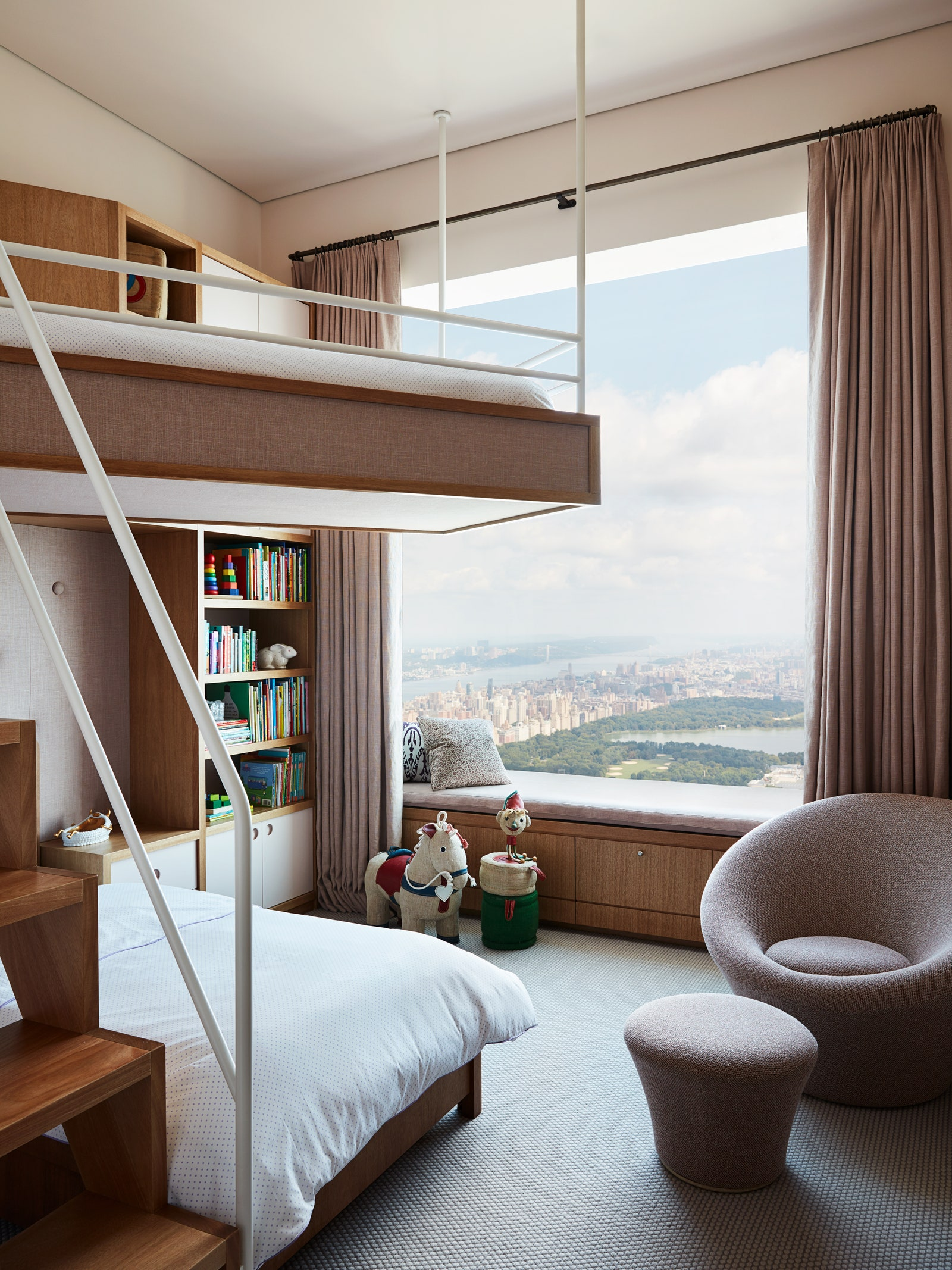 Image may contain Furniture Interior Design Indoors Bed Room Bedroom Housing Building Wood and Living Room