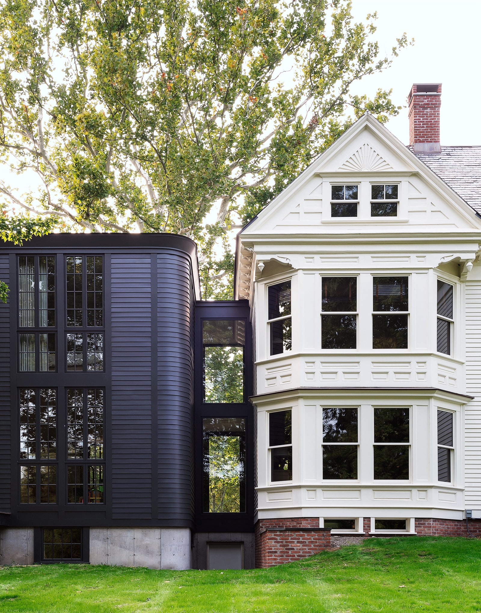 A centuryold sycamore shades the Eastlake Victorian mansion whose renovation and expansion was completed by Workstead.