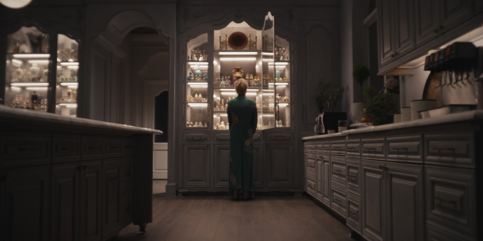 a woman standing in front of a cabinet