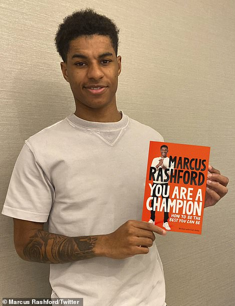 Manchester United player Marcus Rashford with 'You Are A Champion'