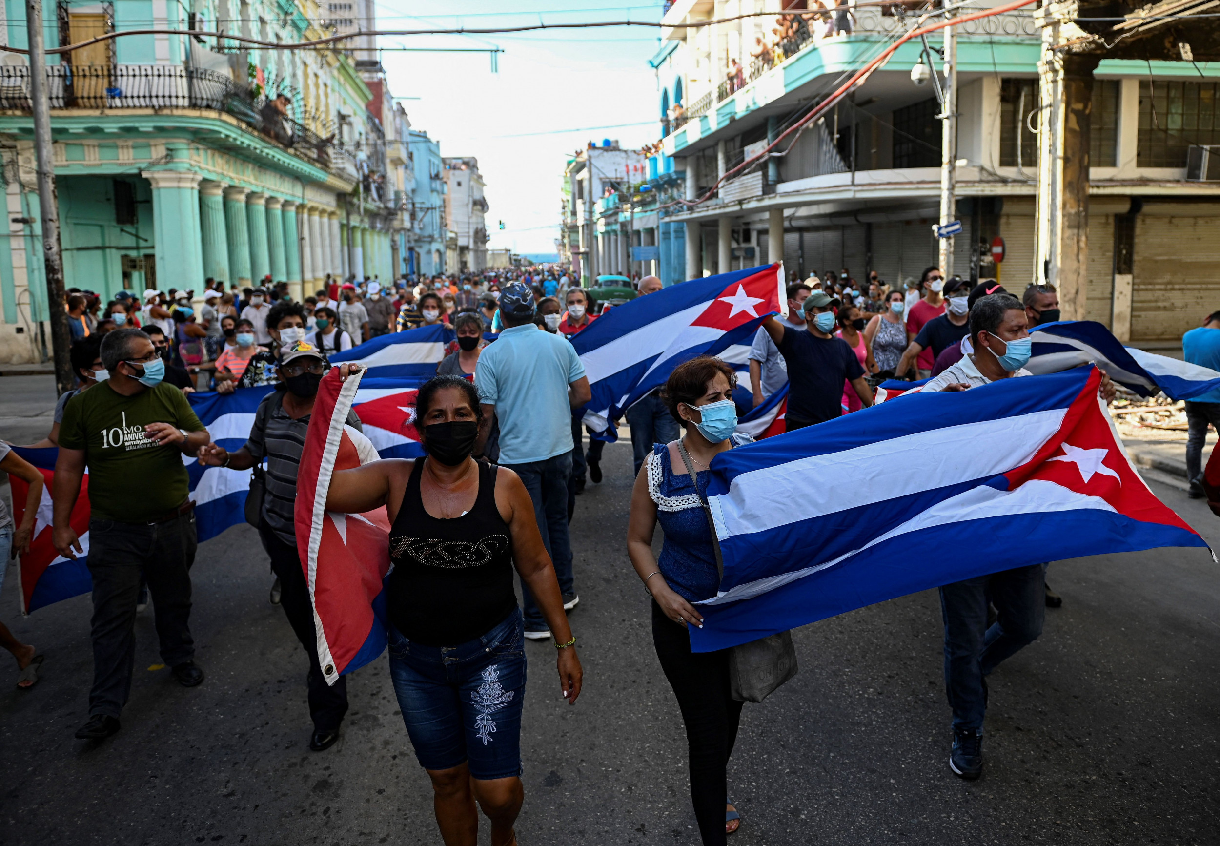 People take part in protests in Havana.